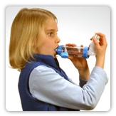 Photo of a young woman using an inhaler for asthma